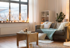 Living room decorated for Christmas with neutral colors.